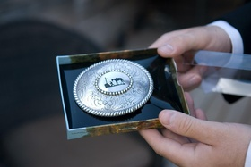 Western belt buckle with horse motif for groom