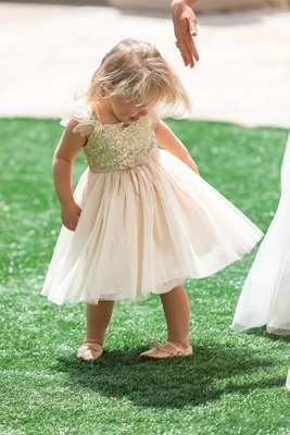 adorable flower girl in dress with gold sequin top and soft blush skirt