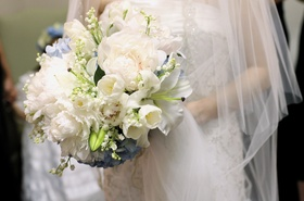 Bride carrying textured bridal bouquet