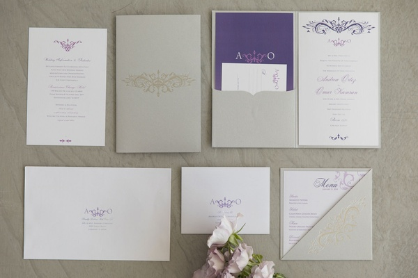 Styled shoot with white purple silver inivtation suite purple script and motif folder menu card
