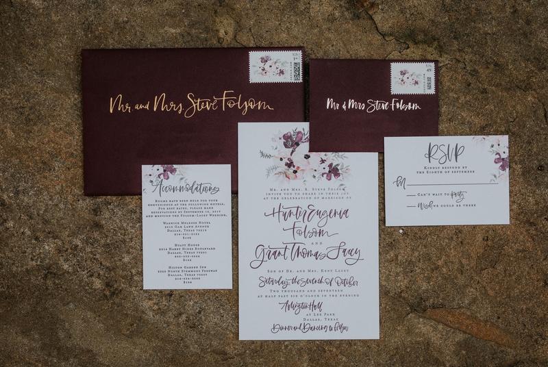 a fabulous fete wedding invitation brush lettering calligraphy gold burgundy envelope flower motif