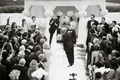 Black and white photo of father giving bride away