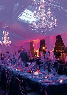 Wedding reception with draping and crystal chandeliers