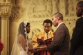 African American bride and groom at church altar