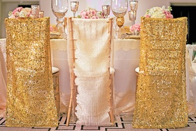 Styled shoot with gold and white linen chair covers