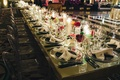 bow-shaped napkins, candle and flower centerpieces candlelit striped dance floor