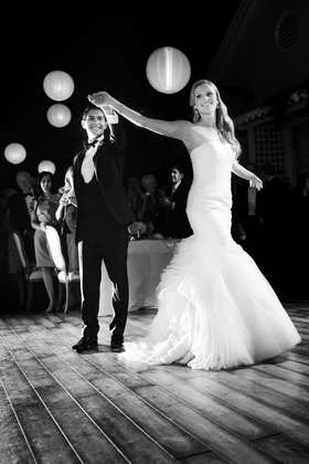 Black and white photo of paper lanterns over dance floor