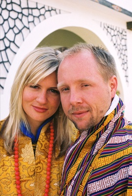 Couple in silk robes at Bhutan wedding ceremony