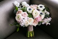 wedding bouquet anemone ranunculus rose ribbon around green stems succulents