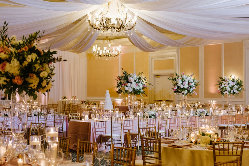 wedding reception in ballroom at the ballantyne resort in charlotte north carolina chandelier drapes