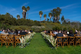 Echosmith singer Sydney Sierota and Cameron Quiseng outdoor wedding ceremony pampas grass vineyard