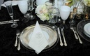 Monogrammed napkin and silver-rimmed glassware