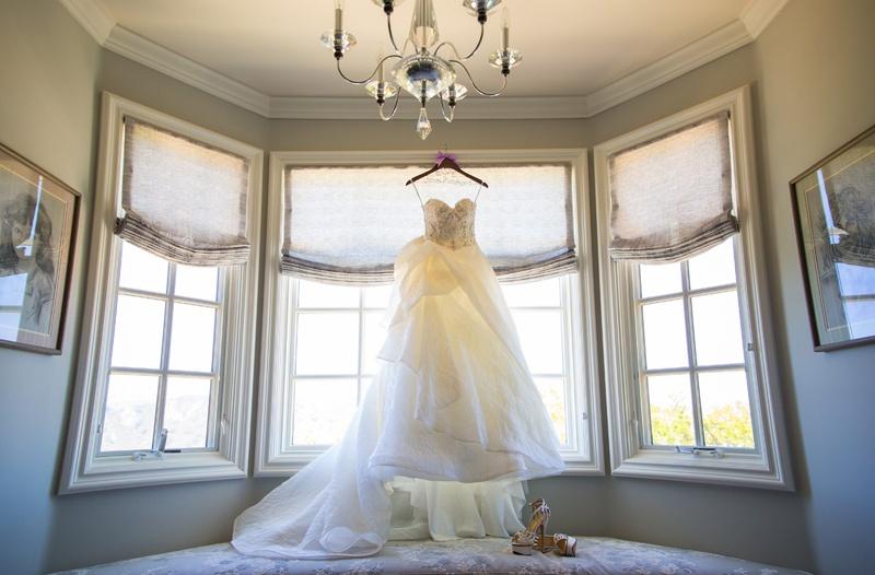 Monique Lhuillier strapless wedding dress in window of bridal suite