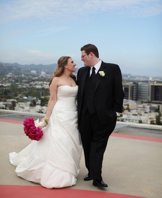Bride in strapless gown and groom in black tuxedo