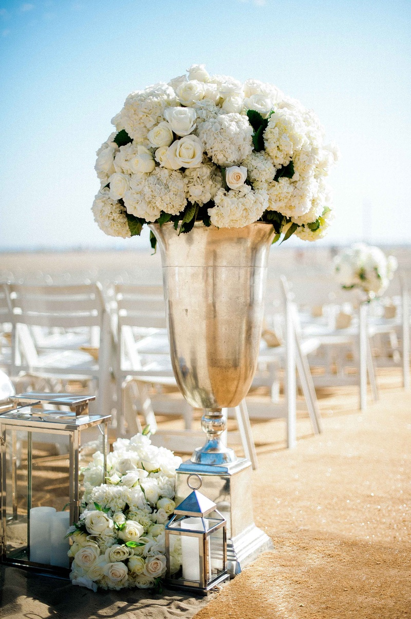 Beach wedding ceremony with tall silver