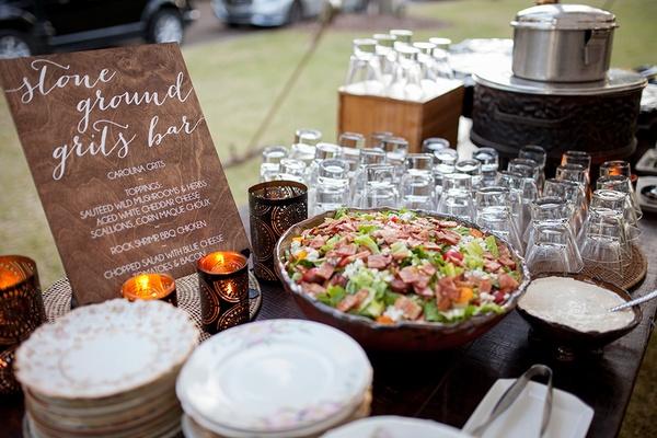 Stone ground grits bar at southern south carolina wedding outdoor reception buffet station