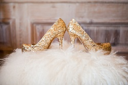 Gold glitter platform wedding shoes on white fur