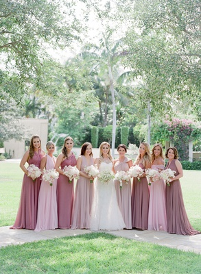 bride in romona keveza wedding dress and bridesmaid dresses pink and mauve dresses white bouquets