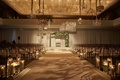 wedding ceremony chicago wide aisle candles geometric chandeliers modern asymmetrical arch ballroom
