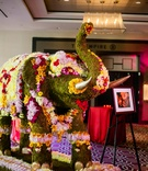 Moss and flower covered elephant on display
