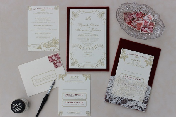 White and gold Zenadia Design wedding invites with vintage stamps