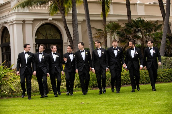 Groom and groomsmen in black and white tuxes at The Breakers wedding venue
