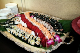 platter filled with different kinds of sushi