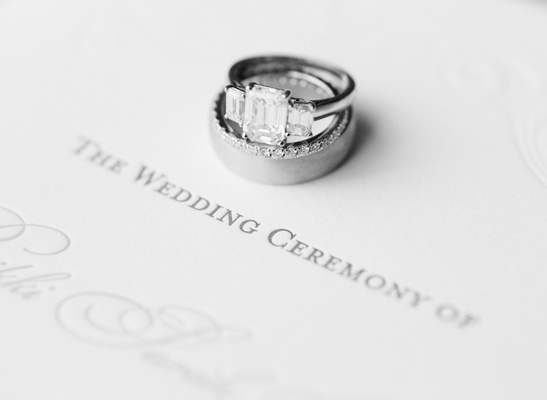 Black and white photo of wedding ring and band