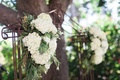 Garden wedding ceremony with metal arch, white hydrangeas and greenery