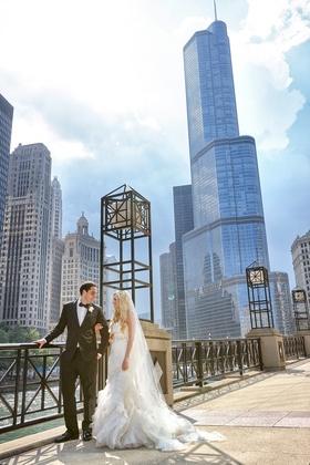 bride in vera wang gown groom in tuxedo, Chicago skyline
