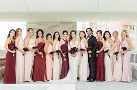 Bride in Ines Di Santo wedding dress bridesmaids in blush, burgundy oxblood dresses bridesman
