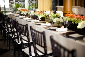 Rectangular table with wood box filled with flowers