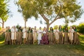 bridal party traditional indian hindu wedding garb two piece outfits bridesmaids groomsmen posing