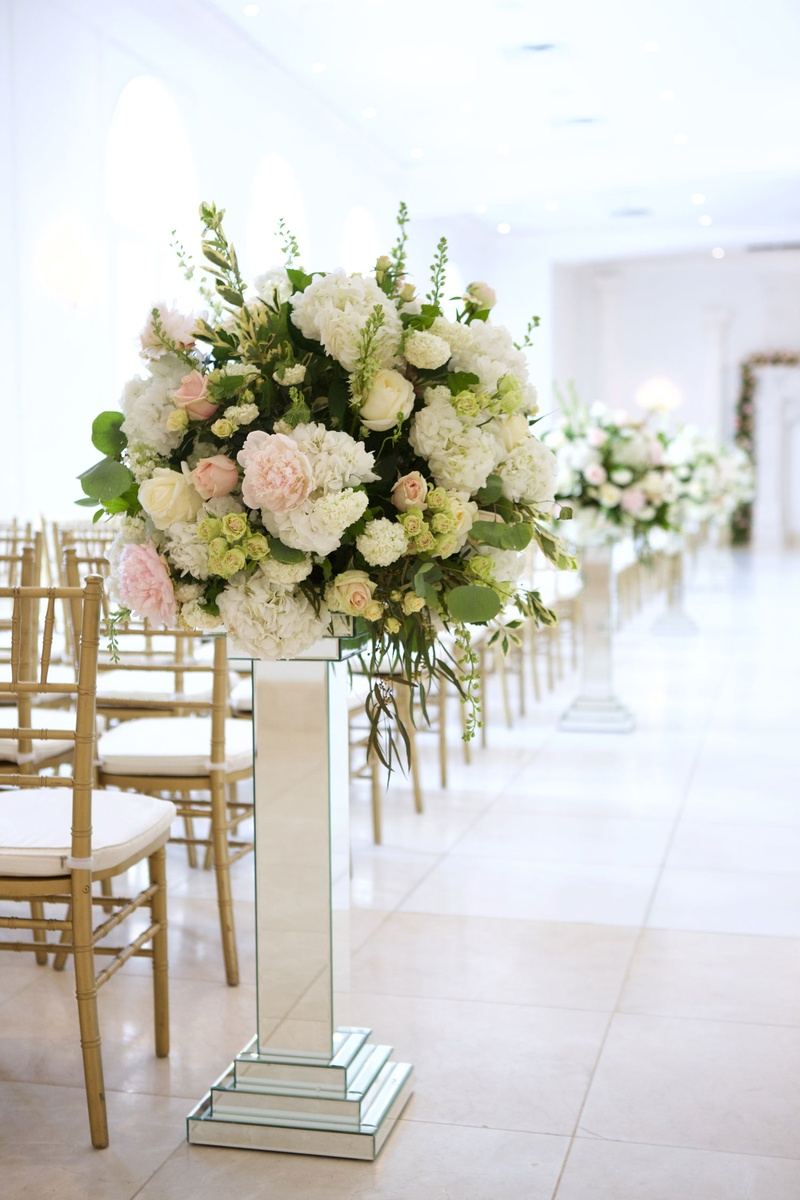 Wedding ceremony gold chairs and mirror riser with greenery pink peony white hydrangea and roses