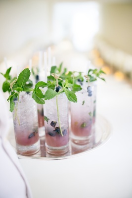 wedding cocktail hour with fresh blueberries and mint