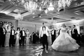 black and white photo of bride and groom on dance floor first dance ball gown chandelier