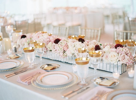 Wedding centerpiece mirror trough with low flower arrangements roses white pink burgundy