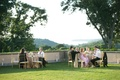 Wedding guests on green lawn at picturesque Oheka Castle in New York