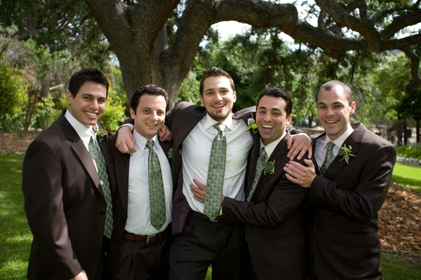 Groom with groomsmen in brown suits and light green ties