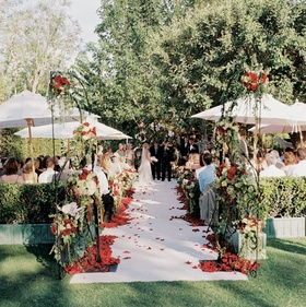 Rosalynn Sumners at end of ceremony aisle under trees