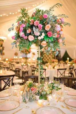 gold stand with eucalyptus, ivy, greenery, pink roses, peach roses