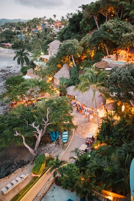 a9f88141d00 ... Wedding welcome party destination wedding in Mexico venue thatched roof  ocean beach property trees ...