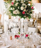 Round table and crystal vase filled with roses
