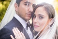 Couple portrait wedding photo under bride's veil solitaire diamond engagement ring soft makeup