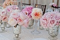 Silver vases with blush roses and garden roses