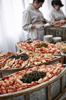 Boats full of crab legs and shrimp at wedding reception