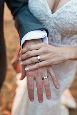 Bride with French manicure and sparkling diamond engagement ring Berta gown groom with polished band