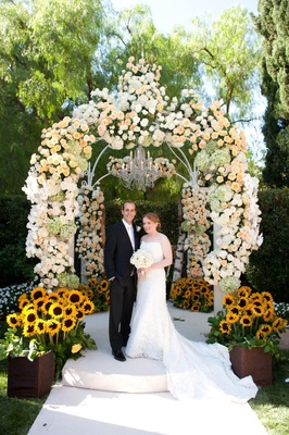 Roses, hydrangeas, and sunflower chuppah