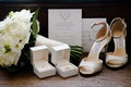 jimmy choo wedding shoes glitter with wedding rings invitation and white rose bouquet