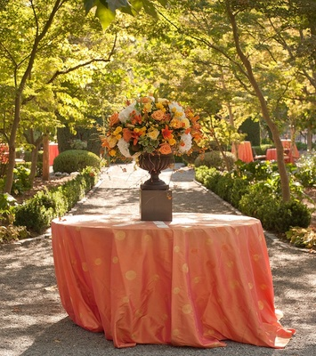 Polka dot tablecloth with autumnal floral arrangement